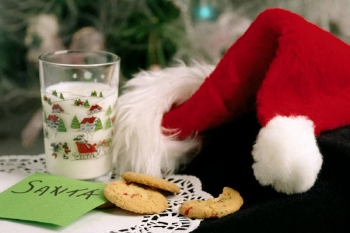 Santa hat, cookies and milk